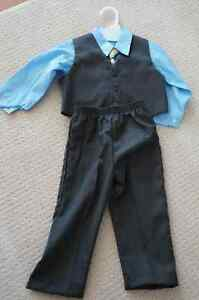 Never Worn boys dress pants, vest, shirt, and tie outfit