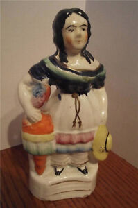 ANTIQUE STAFFORDSHIRE FIGURINE LADY WITH A BIRD