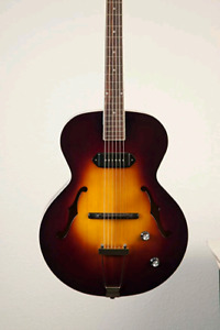The Loar LH-309'stop is hand-carved solid Spruce top like new
