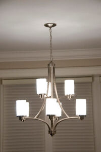 Beautiful contemporary, brushed nickel and glass chandelier.