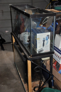 two fish tanks with stand and accessories