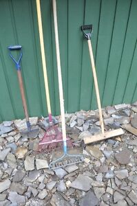 TWO RAKES, ONE EDGER AND BRUSH