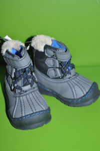 Winter boots for boys. Warm. Size 5. Brand new with tags. Never