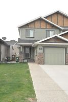 Utilities included Airdrie Kings Heights half duplex with garage