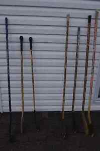 variety of hockey sticks, left and right handed