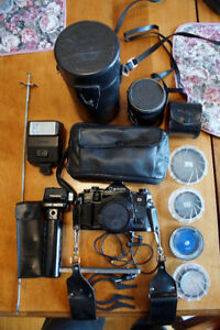 Canon A-1 35mm incl:Power Winder, 4 Lenses,Filters,Flashes,Cases