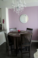 Dining set - round table and four chairs, dark wood