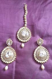 Pure kundan stone earrings and maatha teeka.
