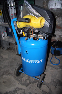Mastercraft air compressor with hose and attachments.