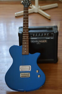 Electric guitar and amp. The guitar is in new condition