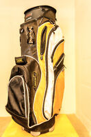Golf bag and a couple of clubs