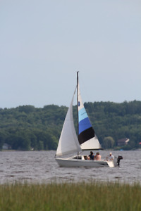 Sailboat Oday 19 foot 1983 model. W/ Trailer & outboard motor.