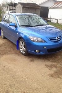Mazda 3 works good ! 1100$ obo