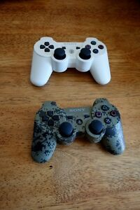 Pair of Playstation 3 controllers Camouflage & White Exc. Cond.