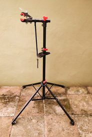 Bicycle repair stand to hold bicycles for repair or service
