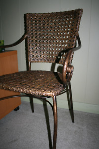 Two coffee coloured Metal and Wicker Chairs.
