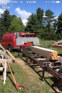 Portable saw mill with operator
