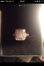 White gold diamond cluster engagement ring