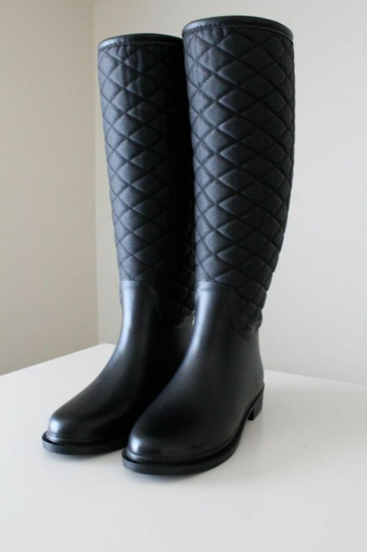 Black boots are an outfit staple.