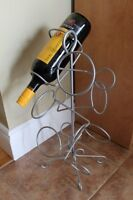 Small silver cast iron wine rack- holds 6 bottles $5