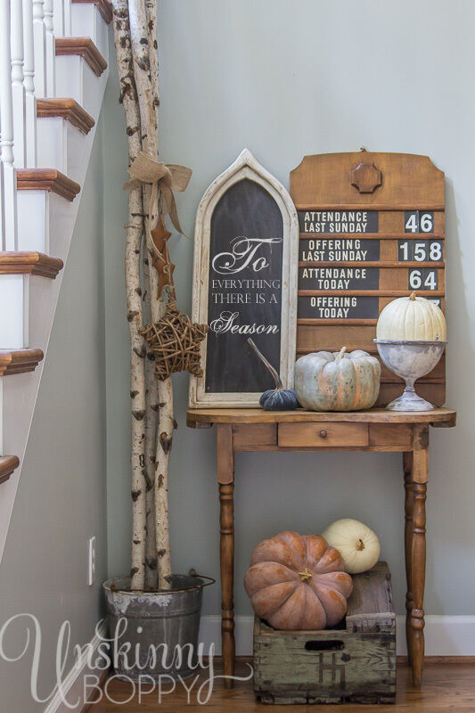 An old church attendance sign surrounded by fall decor and a gothic chalkboard- a perfectly collected vintage vignette.