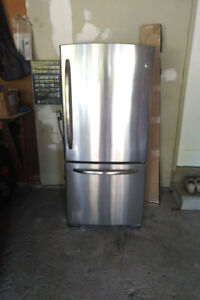 Barely used GE stainless steel fridge for sale.