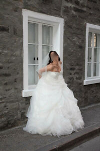 Designer wedding dress - moving and needs to sell it