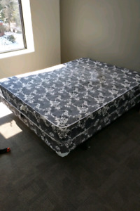 Nice Queen sized mattress and boxspring and metal frame