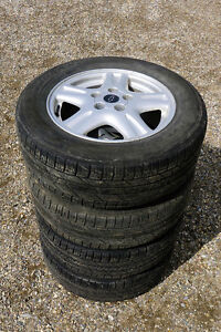 """Four Used Goodyear Tires Mounted On 16"""" Chev Rims"""