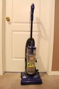 Various upright vacuum cleaners.