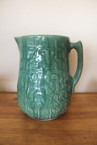 Old Pottery Jug In Green
