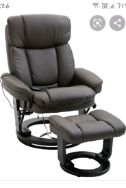 Massage chair. electric dark brown with matching stool.