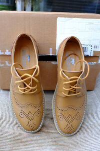 Shoe is a classic open-laced 'Derby'
