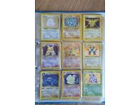 Folder full of Pokemon cards, offers