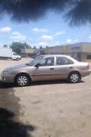 2002 Toyota Corolla Sedan. Lady Driven. Safety and E-tested.