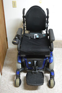 Power wheelchair with charger