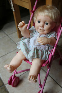 Vintage used 'Real Baby' heavy doll and stroller
