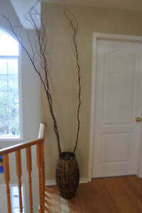 Large woven vase with long twigs decor