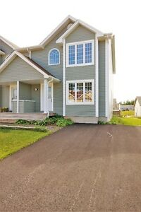 NEW semi! Paved driveway, landscaped!! Owners motivated!