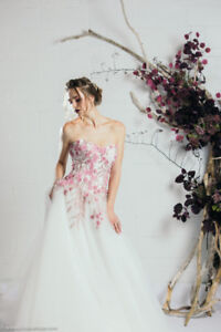 Selling new  wedding gown in a size small