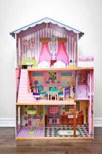 Large doll house with furniture pieces.