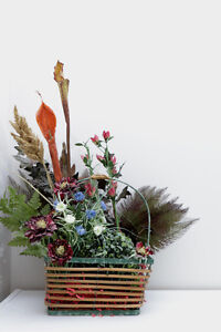 Artificial Flowers in a Metal and Bamboo Basket