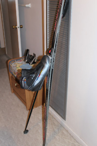 Skis with ski boots and poles