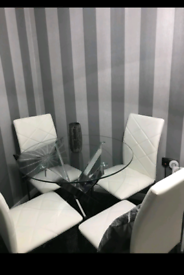 Glass table and 4 white chairs
