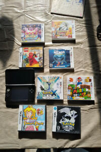 3DS with  8 games and collectors addition caring bag