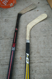 Bauer challenger ice skates and hockey sticks one 30