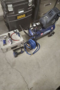 8 Gallon Campbell Hausfeild air compressor with accessories
