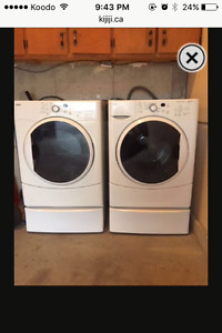 MOVING SALE-Kenmore front load washer and dryer with stands