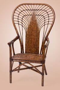 Elegant and durable highback rattan chair with leather binding