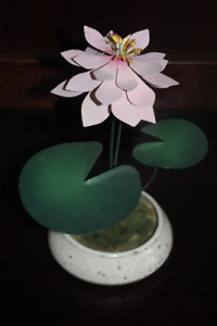 Decorative Metal Flower in Pottery Base